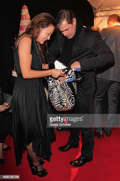 Sonja Kirchberger and Sven Martinek search in the handbag at the Bild 'Place to B' Party during the 64th Berlinale International Film Festival on...