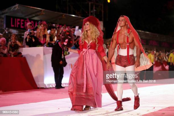 Sonja Kraus and a model walk the carpet during the Life Ball 2018 show at City Hall on June 2 2018 in Vienna Austria The Life Ball an annual charity...