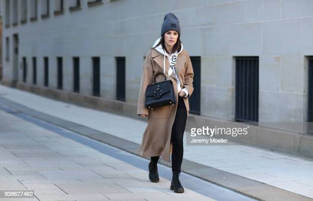 Sonja Paszkowiak from Shoppisticated wearing a Esprit coat and hoodie Monki pants Dr Martens and a Acne cap on January 08 2018 in Hamburg