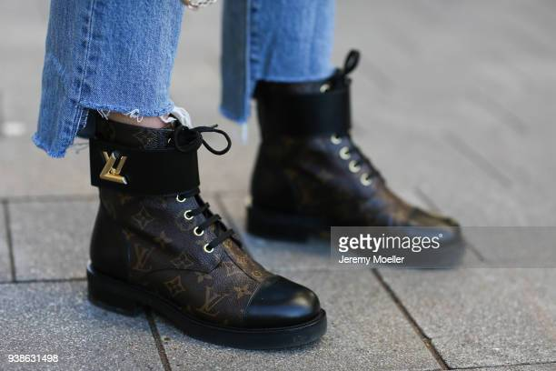 Sonja Paszkowiak from Shoppisticated wearing Valentino bag Levis Jeans and Louis Vuitton boots on January 08 2018 in Hamburg