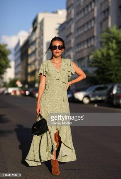 Sonja Paszkowiak wearing a Rayban sunglasses via Sunglass Hut and Chanel bag on July 01, 2019 in Berlin, Germany.