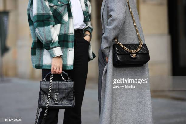 Sonja Paszkowiak wearing coat and sweater, Chanel bag and Maike Schmitz wearing flannel, Closed shirt, Levi's Ribcage jeans, YSL bag on December 15,...