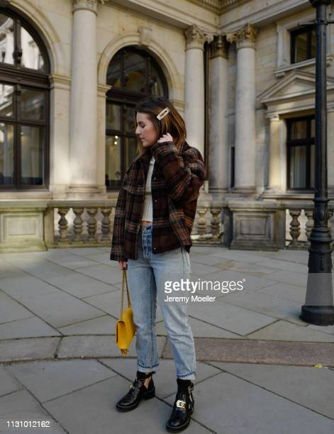 Sonja Paszkowiak wearing Mango jacket ASOS top Levi's 501 jeans Balenciaga shoes and Saint Laurent bag on February 18 2019 in Hamburg Germany