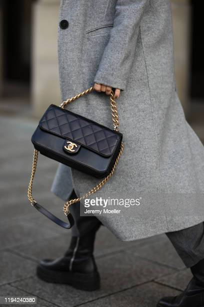 Sonja Paszkowiak wearing Zara pants, shoes, coat and sweater and Chanel bag on December 15, 2019 in Hamburg, Germany.