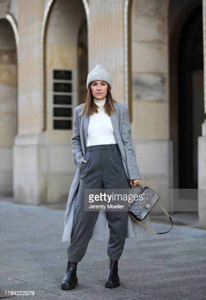 Sonja Paszkowiak wearing Zara pants, shoes, coat and sweater, Ganni hat and Chanel bag on December 15, 2019 in Hamburg, Germany.