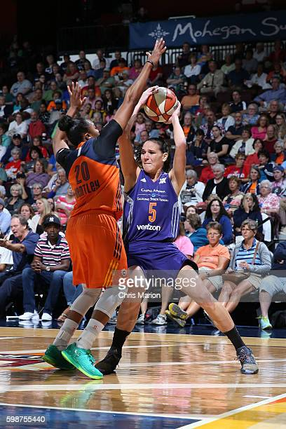 Sonja Petrovic of the Phoenix Mercury handles the ball against Alex Bentley of the Connecticut Sun during a WNBA game on September 2 2016 at the...