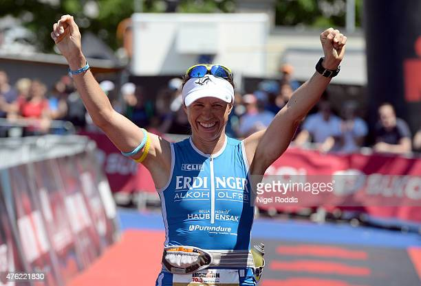 Sonja Tajsich of Germany celebrates after finishing second in the women's race during the Ironman 703 RapperswilJona on June 7 2015 in Rapperswil...