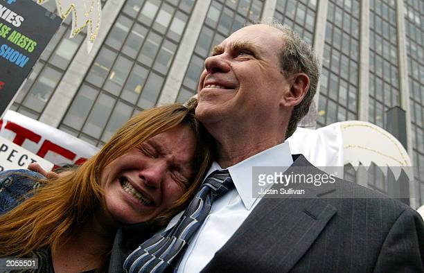 Sonjia Miles of San Francisco cries as she hugs Medical marijuana grower Ed Rosenthal as he leaves the San Francisco Federal building June 4 2003 in...