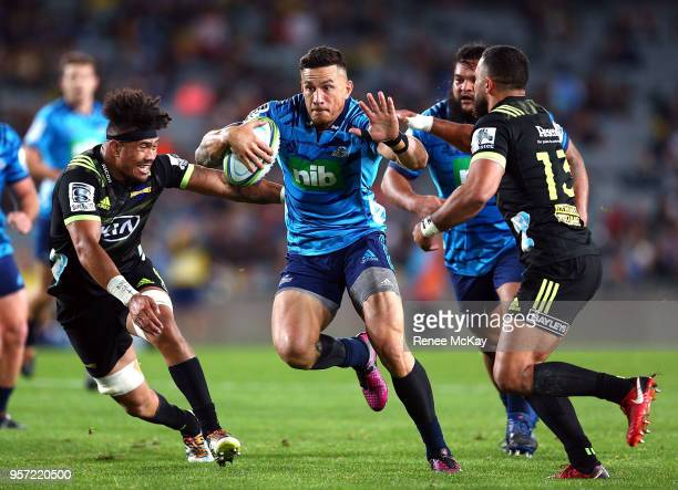 Sonn Bill Williams of the Blues fends off the Hurricanes defence during the round 12 Super Rugby match between the Blues and the Hurricanes at Eden...