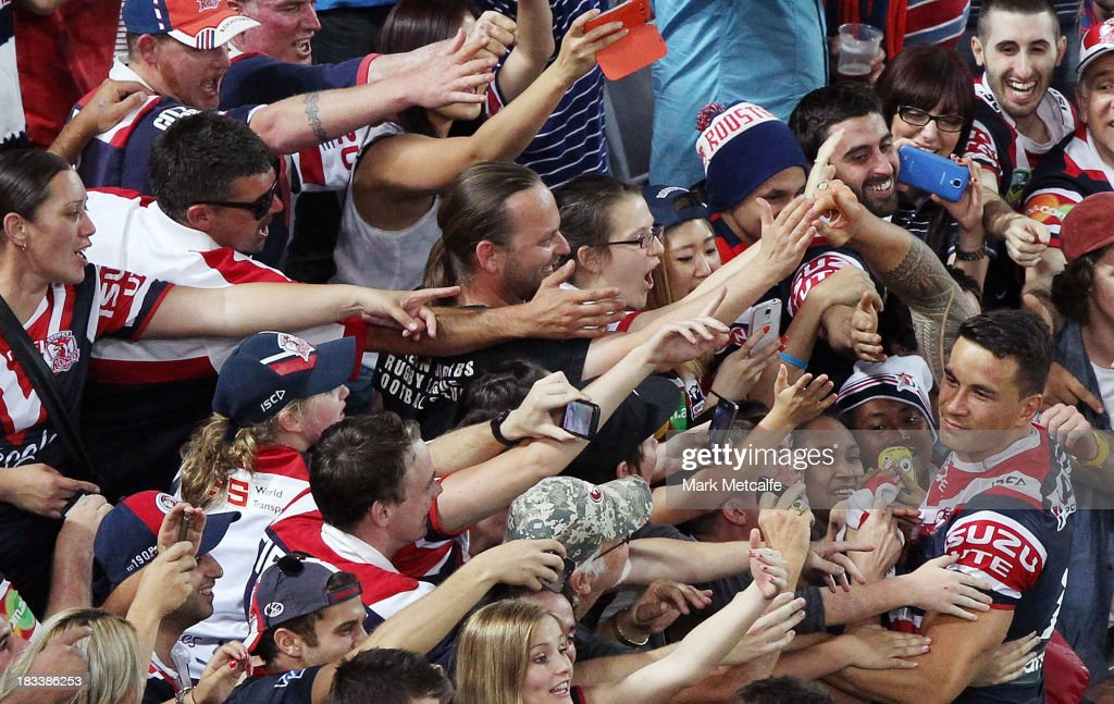 Sonny Bil Williams of the Roosters celebrates with fans after winning the 2013 NRL Grand Final match between the Sydney Roosters and the Manly Warringah Sea Eagles at ANZ Stadium on October 6, 2013 in Sydney, Australia.