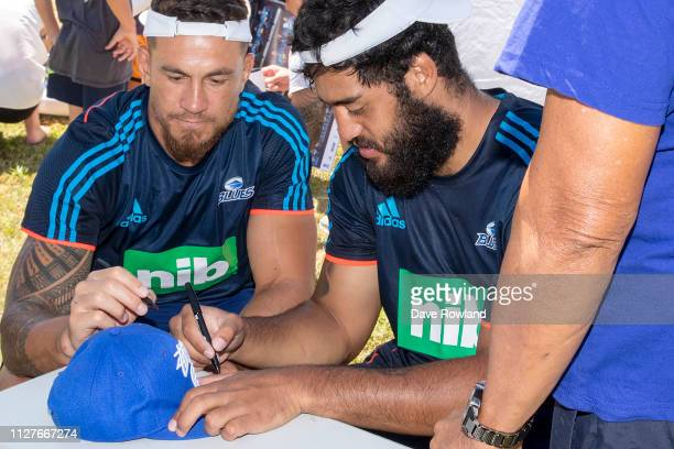 Sonny Bill Williams and Akira Ioane signing autographs during the Auckland Blues Block Party at Alexandra Park on February 06 2019 in Auckland New...