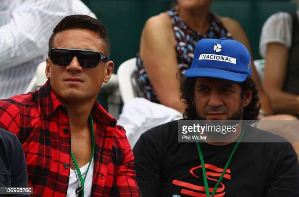 Sonny Bill Williams and his manager Khoder Nasser look on during day six of the 2012 Heineken Open at the ASB Tennis Centre on January 14 2012 in...