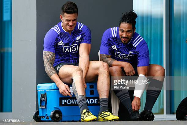 Sonny Bill Williams and Ma'a Nonu of the All Blacks remove their boots following a New Zealand All Black training session at Trusts Stadium on August...