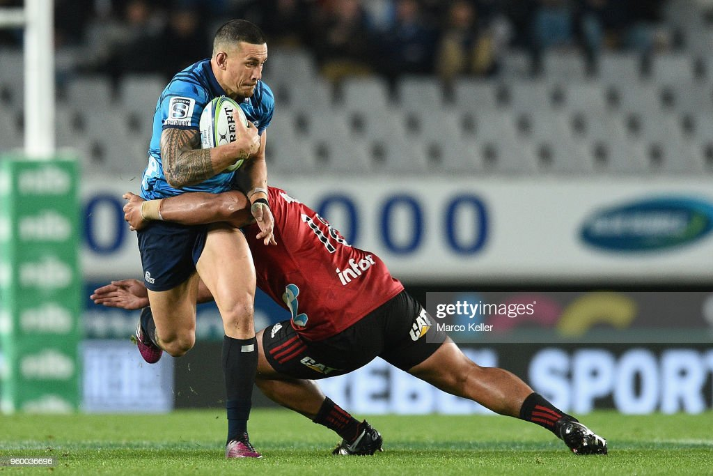 Sonny Bill Williams is tackled by Ofa Tuungafasi during the round 14 Super Rugby match between the Blues and the Crusaders at Eden Park on May 19, 2018 in Auckland, New Zealand.