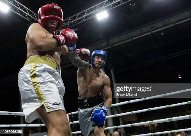 Sonny Bill Williams lands a punch on Stuart Landry during the Banger Under the Hangar Charity Fight Night at The Historic Locomotive Workshops on...