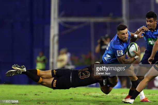 Sonny Bill Williams of Blues is tackled by Matias Moroni of Jaguares during a Super Rugby Rd 3 match between Jaguares and Blues at Jose Amalfitani...