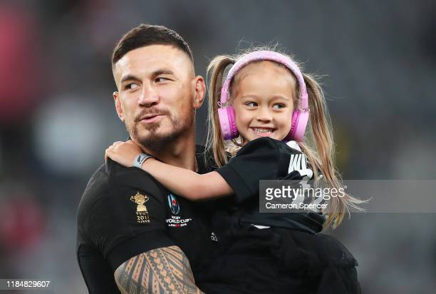 Sonny Bill Williams of New Zealand and his daughter Imaan react as they walk around the pitch following his team's victory in the Rugby World Cup...