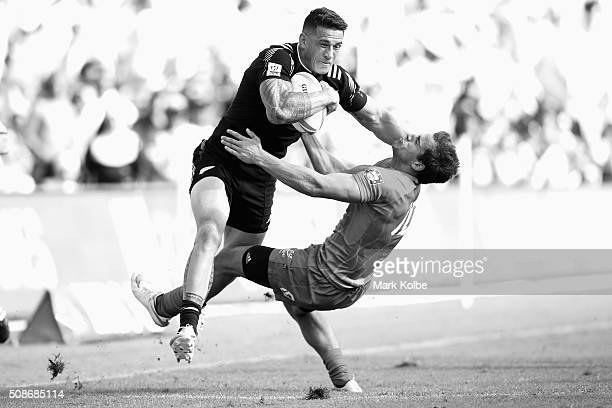 Sonny Bill Williams of New Zealand bumps out of the tackle from Tiago Fernandes of Portugal during the 2016 Sydney Sevens at Allianz Stadium on...