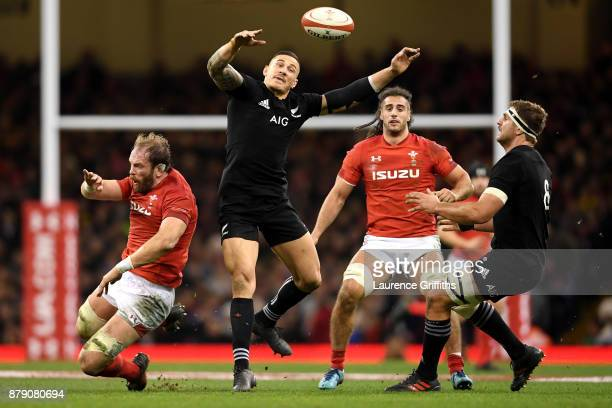 Sonny Bill Williams of New Zealand claims a high ball while under pressure from Alun Wyn Jones of Wales during the International match between Wales...