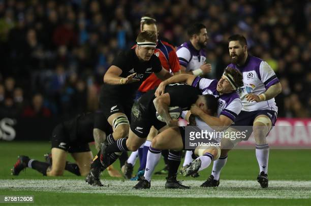 Sonny Bill Williams of New Zealand is tackled by Hamish Watson of Scotland during the International test match between Scotland and New Zealand at...