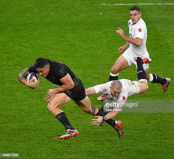Sonny Bill Williams of New Zealand is tackled by Mike Brown of England during the QBE International betwen England and New Zealand at Twickenham...