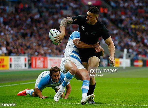Sonny Bill Williams of New Zealand offloads in the tackle during the 2015 Rugby World Cup Pool C match between New Zealand and Argentina at Wembley...
