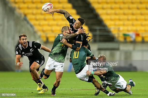 Sonny Bill Williams of New Zealand offloads to Joe Webber in the tackle of Francois Hougaard Rosko Specman and Philip Snyman of South Africa during...