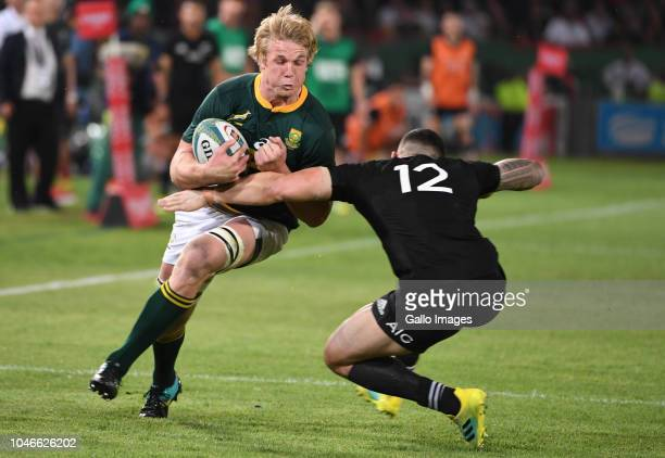 Sonny Bill Williams of New Zealand tackles PieterSteph du Toit of the Springboks during the Rugby Championship match between South Africa and New...