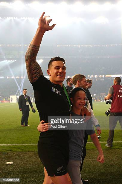Sonny Bill Williams of New Zealand takes young fan Charlie Lines on a lap of honor during the 2015 Rugby World Cup Final match between New Zealand...