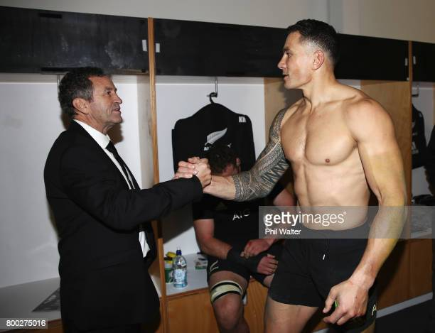 Sonny Bill Williams of the All Blacks and assistant coach Wayne Smith celebrate in the dressing room after the first test match between the New...