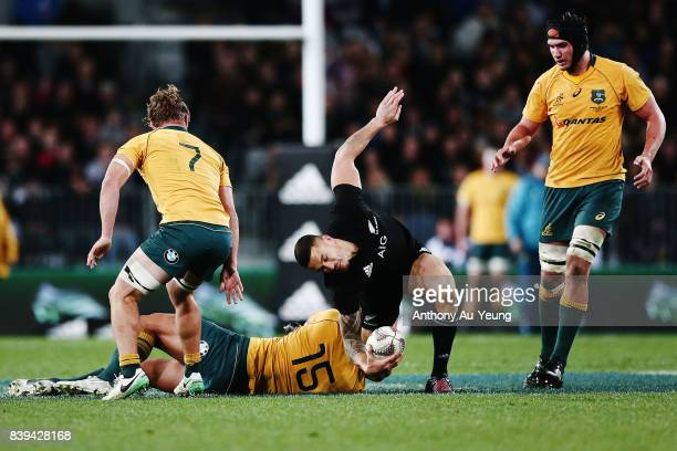 Sonny Bill Williams of the All Blacks is tackled by Israel Folau of the Wallabies during The Rugby Championship Bledisloe Cup match between the New...