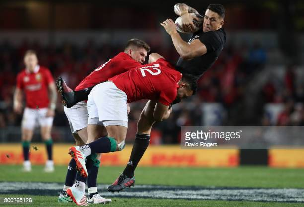 Sonny Bill Williams of the All Blacks is tackled by Owen Farrell and Ben Te'o of the Lions during the first test match between the New Zealand All...