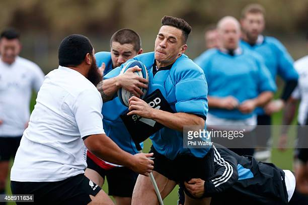 Sonny Bill Williams of the All Blacks is tackled during a New Zealand All Blacks training session at Peffermill on November 13 2014 in Edinburgh...