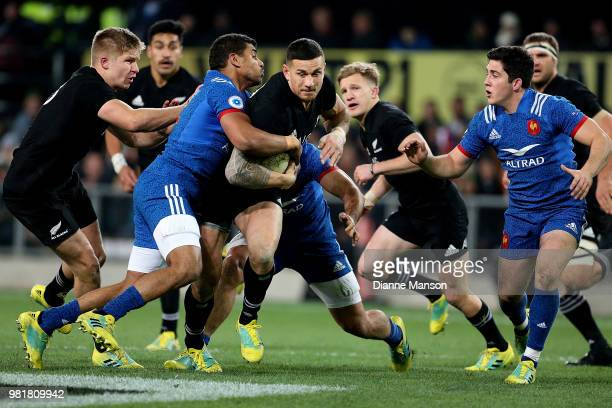 Sonny Bill Williams of the All Blacks is tackled during the International Test match between the New Zealand All Blacks and France at Forsyth Barr...