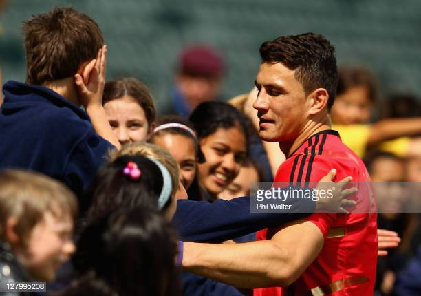 Sonny Bill Williams of the All Blacks meets with young fans following a New Zealand IRB Rugby World Cup 2011 training session at North Harbour...