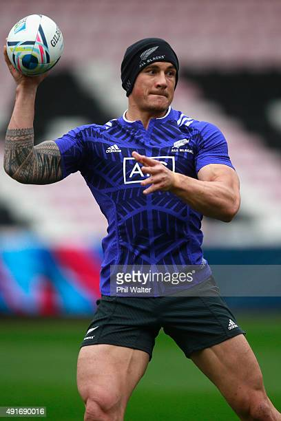 Sonny Bill Williams of the All Blacks passes during a New Zealand All Blacks training session at Mowden Park on October 7 2015 in Darlington United...