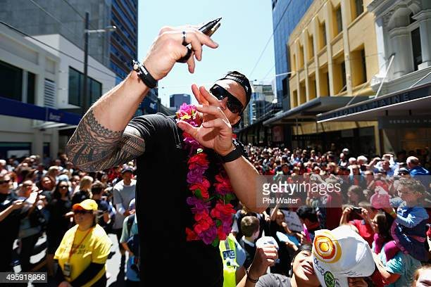 Sonny Bill Williams of the All Blacks poses for photos with fans during the New Zealand All Blacks Welcome Home celebration on November 6 2015 in...