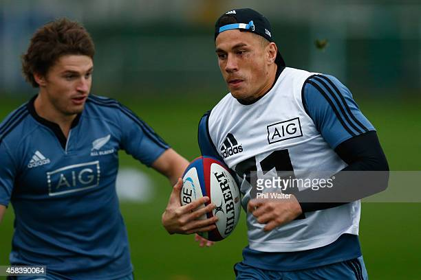 Sonny Bill Williams of the All Blacks runs the ball during a New Zealand All Blacks training session at Latymers on November 4 2014 in London England