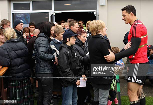 Sonny Bill Williams of the All Blacks signs autographs for Christchurch residents who lost family and friends in the earthquake following a New...