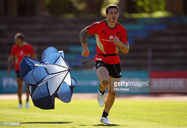 Sonny Bill Williams of the All Blacks tows an umbrella during the New Zealand All Blacks Training Session at Xerox Arena on August 16, 2011 in Port...