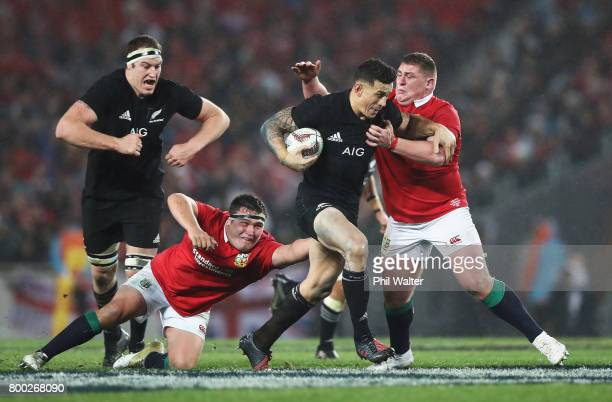 Sonny Bill Williams of the All Blacks tries to break clear from Jamie George and Tadhg Furlong of the Lions during the first test match between the...