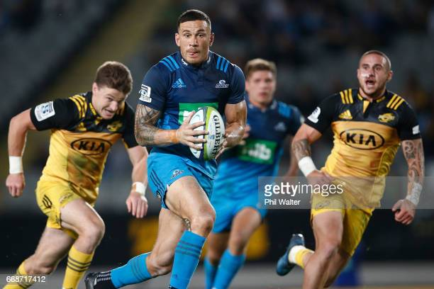 Sonny Bill Williams of the Blues makes a break during the round eight Super Rugby match between the Blues and the Hurricanes at Eden Park on April 15...