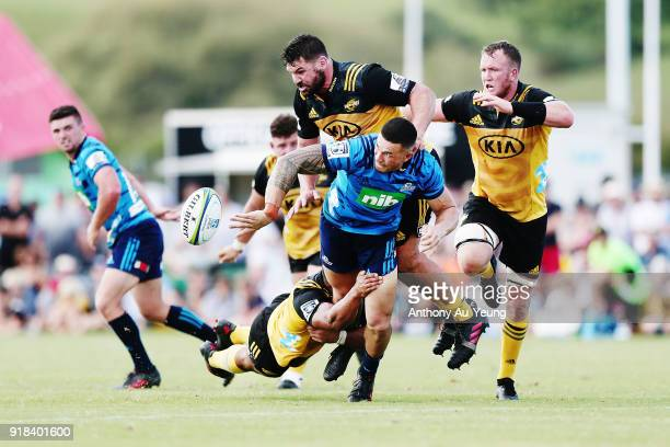 Sonny Bill Williams of the Blues offloads in a tackle during the Super Rugby trial match between the Blues and the Hurricanes at Mahurangi Rugby Club...