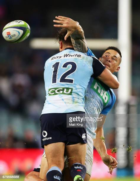 Sonny Bill Williams of the Blues offloads the ball in a tackle during the round 11 Super Rugby match between the Waratahs and the Blues at Allianz...