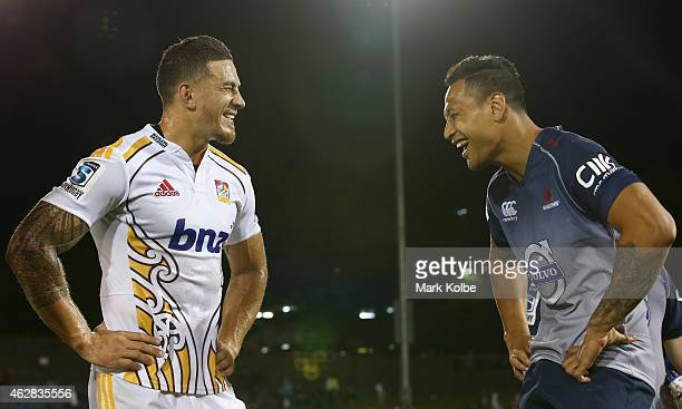 Sonny Bill Williams of the Chiefs and Israel Folau of the Waratahs share a joke after the Super Rugby trial match between the Waratahs and Chiefs at...