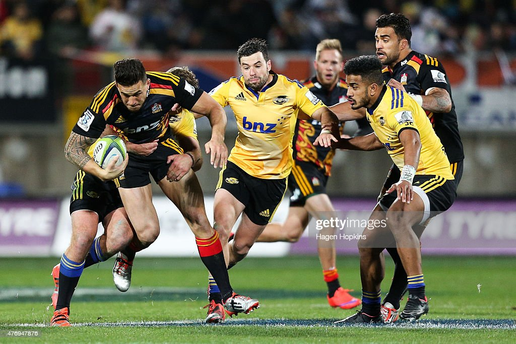 Sonny Bill Williams of the Chiefs is tackled during the round 18 Super Rugby match between the Chiefs and the Hurricanes at Yarrow Stadium on June 13, 2015 in New Plymouth, New Zealand.