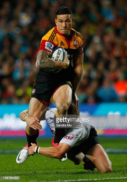 Sonny Bill Williams of the Chiefs is tackled during the Super Rugby Final between the Chiefs and the Sharks at Waikato Stadium on August 4, 2012 in...