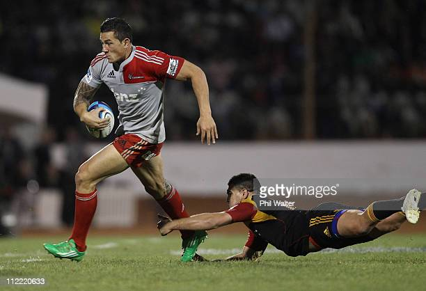 Sonny Bill Williams of the Crusader is tackled by Dwayne Sweeney of the Chiefs during the round nine Super Rugby match between the Chiefs and the...
