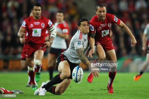 Sonny Bill Williams of the Crusaders competes with Quade Cooper of the Reds during the 2011 Super Rugby Grand Final match between the Reds and the...