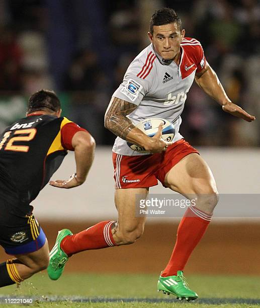 Sonny Bill Williams of the Crusaders looks past Dwayne Sweeney of the Chiefs during the round nine Super Rugby match between the Chiefs and the...